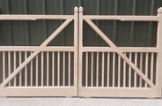 Oak gates with spindles cut into the braces